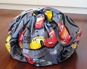 Play and Store Mat - cars in red and yellow with dark grey background