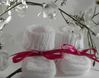 PAIR OF WHITE BOOTIES MADE BY CRAFTSMEN