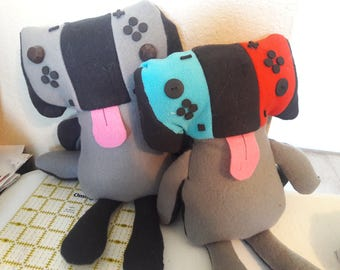 Switchers. Plush dog that resembles a new video game console.