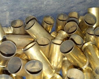 50 rounds of 10mm once fired, uncleaned brass shell casings
