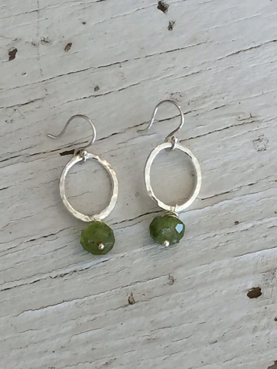 Peridot drop. Earrings with faceted peridot rondelles suspended from hand-forged fine silver ovals. Handmade OOAK by ladeDAH! Jewelry.