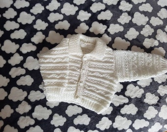 White hand knitted baby cardigan