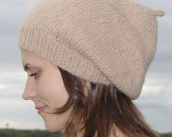 2 Berets, one traditional knit in stockinette stitch, one slouchy knit in a lace pattern. PDF knitting pattern