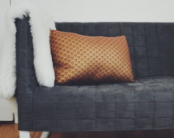 Red and Gold Patterned Pillow