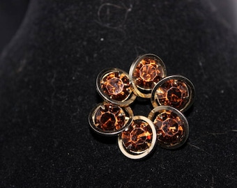 Lovely small brooch with amber colored stones - Unsigned