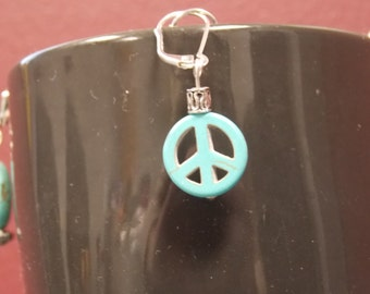in honor of Manchester peace sign earrings
