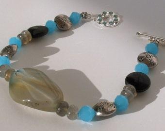 Blue and Gray Jasper Labradorite Black Carved Onyx Bracelet