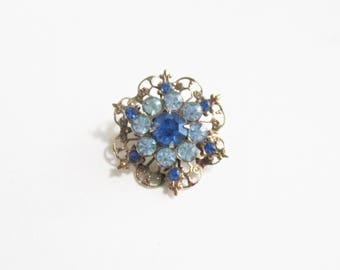 Vintage Brooch Blue Rhinestone Fleur de Lis Antique Gold Tone Metal