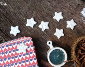 Christmas decorations in the shape of stars, set of 7 white stars