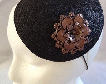 Black braided straw fascinator with copper metal filagree flower