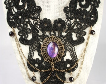 Black lace necklace with purple glass cabochon.