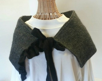 Gray caplet with black ruffle and tie