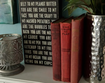 Set of 3 red leather bound books
