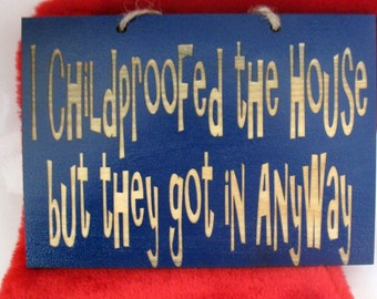 I childproofed the house but they got in anyway wooden sign