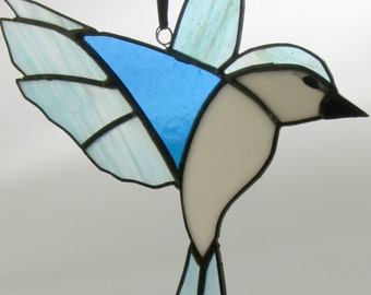 Handcrafted winter flying bird suncatcher, copper-foiled stained glass in blue & white
