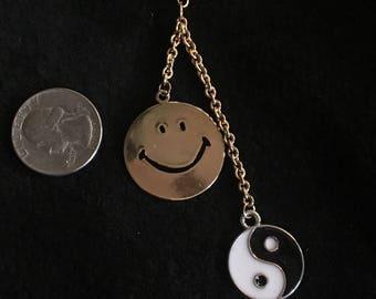 Smiley face and yin yang dangle