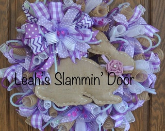 Hop into spring with this adorable  purple white and burlap deco mesh wreath!