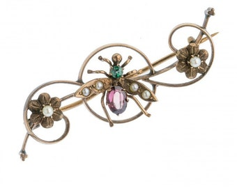 Victorian insect pin in rose gold with blue zircon, garnet and seed pearls. pnvc764