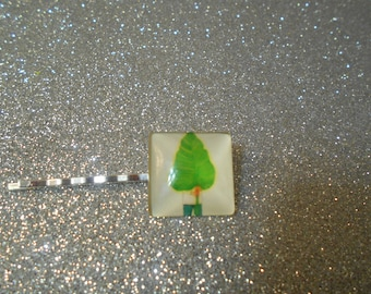 Square cabochon with green tree against a white back ground #731