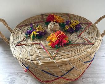 Lidded basket with handles