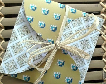 Greeting card and envelope - CA19, square format, which opens as a gift, motive arabesques yellow ochre and blue