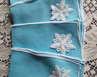 Vintage set of 4 Robin egg blue linen napkins with white snowflake detail.