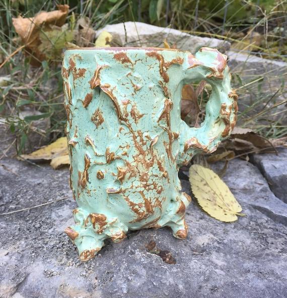 medium sized ceramic mug in pale green and rust brown