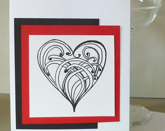 Hand Drawn  Heart design Doodle Drawing Greeting Card for Any Occasion in Black Red and White.