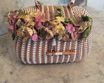 Ladies' woven rattan purse with floral decorations