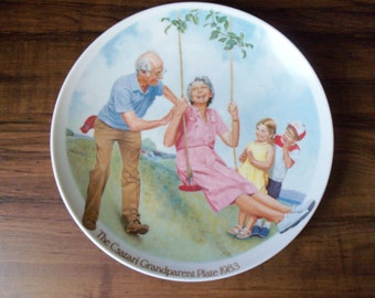 """Knowles Limited Only Edition porcelain plate""""The Csatari Grandparent-Swinger"""" . Made in USA  (#EV417)"""