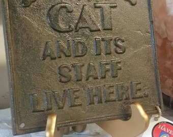 "Antique Style Hilarious Cat Plaque. Cast Iron, Rustic Antiqued Finish. ""A Cat and it's Staff Live Here"" Wall Decor."