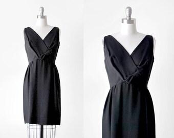 60's black crepe dress. bow. 1960 cocktail dress. mini. small.