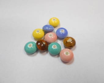 10 ceramic beads size 12 mm by 7 mm lot number 4