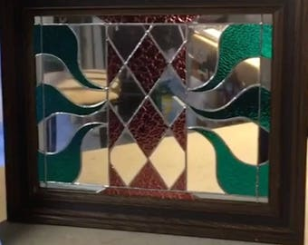 Stained glass wall hanging in wood frame