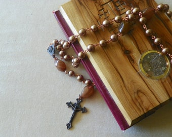 Brown glass pearl rosary made with copper medal and crucifix(.)