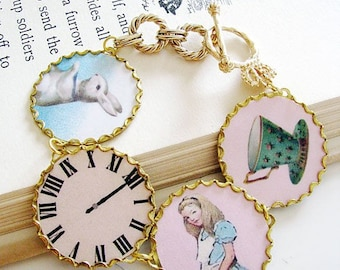Alice In Wonderland bracelet. the white rabbit, wristwatch, alice and teacup with crown and scepter toggle