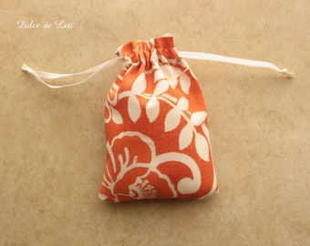 Jewelry gift bag. Orange floral print pouch. Cotton fabric drawstring gift pouch. Wedding favor sachet bag.