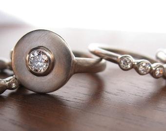 Unique engagement ring, circular diamond setting, Helios Ring 950 Palladium and Diamond engagement ring