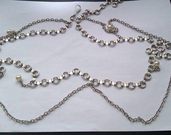 silver coloured metal belt
