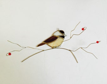 Chickadee stained glass suncatcher on a 3 dimentional wire branch with green glass leaves .Realistic Bird.