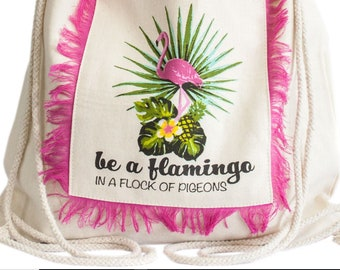 Drawstring backpacks fringed in asssorted designs