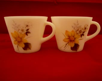 Two Pyrex tea cups
