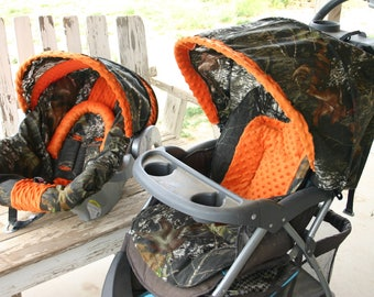 Carseat and stroller not included: mossy oak and orange car seat COVER and hood COVER with matching stroller hood COVER and seat cushion