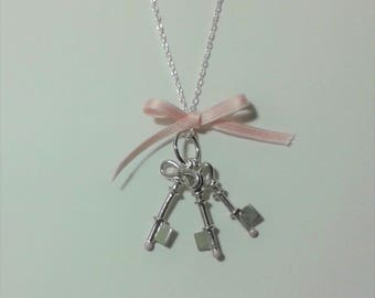 Pendant keys you'll get lucky for pregnant woman and unborn child in silver and enamel