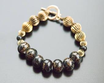Black and Gold Bracelet - Ceramic Black Beads, Antique Gold Beads, Black Bracelet, Gifts For Her, Anniversary Gift For Woman, Flower Design
