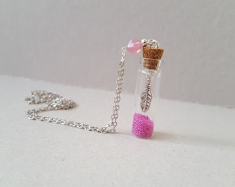 Pink feather vial necklace