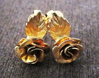 Vintage gold rose clip on earrings.
