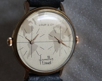A Vintage French  Dual Time Watch.  A watch with two time zones. Rare Watch