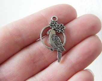 8 Parrot charms antique silver tone B17
