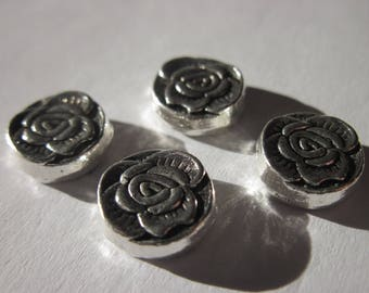 4 reversible 1 cm silver metal flower shaped beads (1955)